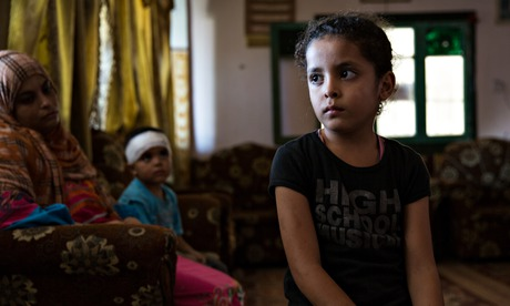 Najia Warshagha at her uncle's house in Beit Lahia, Gaza Strip. She was injured at the UNRWA school, supposedly providing safety for families fleeing the fighting. In the background is her mother Majdolen and injured brother Ali. Photograph: Sean Smith for the Guardian
