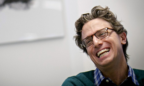 BuzzFeed's Founder and CEO Peretti reacts during an interview in New York
