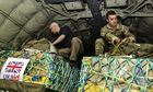 UK humanitarian aid being checked on a Hercules C-130 transport aircraft.