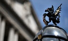 LONDON, ENGLAND - AUGUST 07:  A City of London Griffin sits atop a lamp post in front of the Bank of