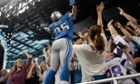 Detroit Lions running back Joique Bell jumps in the stands to celebrate with fans after scoring a touchdown against the Minnesota Vikings