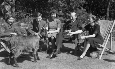 British Deputy Prime Minister Clement Attlee (1883 - 1967) with his wife, three of their children and their pet goat Mary, in the garden at their home in Stanmore, Middlesex, April 1943.