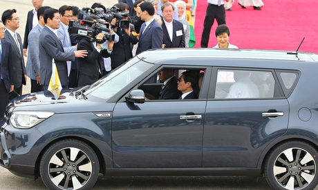 Pope Francis in a Kia Soul
