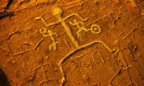Petroglyph man on red rock, Puako, Hawaii