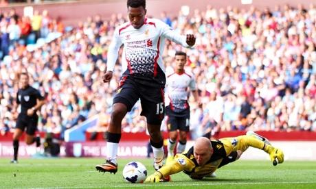 Daniel Sturridge of Liverpool rounds Brad Guzan of Aston Villa
