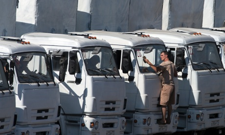 A fleet of lorries that Russia says is carrying humanitarian aid for Ukraine is parked at a camp near the border. Photograph: Pavel Golovkin/AP
