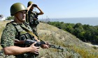 Ukrainian border guards patrol near the small Ukrainian city of Novoazovsk in the Donetsk region