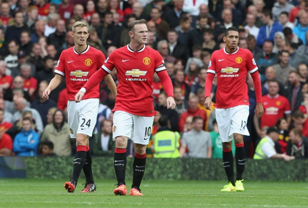 ... as Rooney, Smalling and Fletcher look dejected.