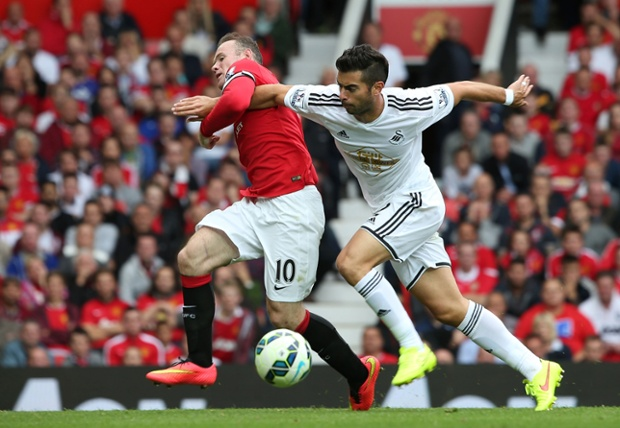 Swansea are holding on well, Jordi Amat battles for the ball.
