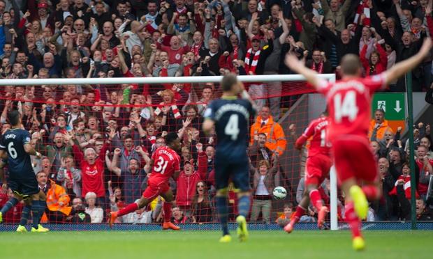 Liverpool's Raheem Sterling scores.