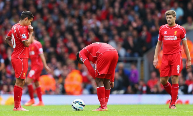 Liverpool's players look dejected after conceding.