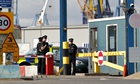 Policemen stand guard at Tilbury docks