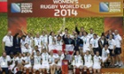 England's players celebrate after winning the Women's Rugby World Cup