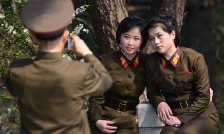 Members of the Korean People's Army pose for a photo near the site of late North Korean leader Kim Il-sung's house on 15 April, 2014, in Pyongyang, North Korea.