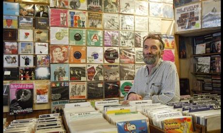 A shop assistant inside the Stand Out/Minus Zero record shop, Blenheim Crescent London