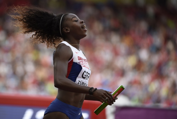 Great Britain's Desiree Henry reacts after crossing the finish line to win the Women's 4x100m final.