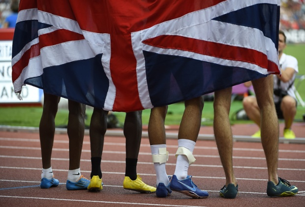 Great Britain's relay team pose for pictures after winning gold in the Men's 4x400m.