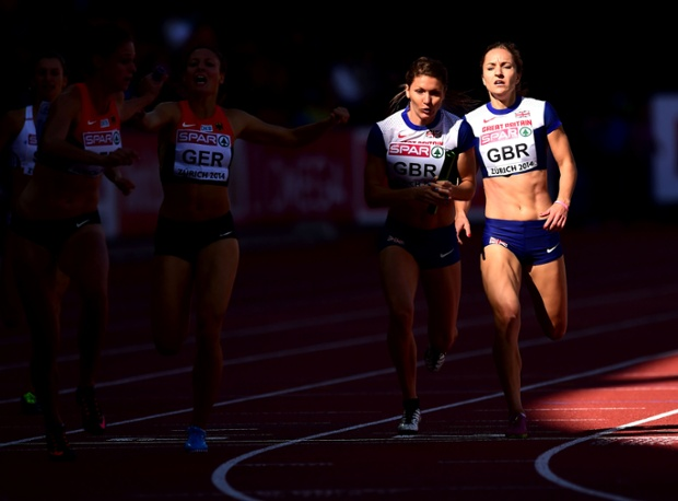 Great Britain's Emily Diamond, right, hands over to Kelly Massey in the Women's 4x400m Relay qualifiers.  The team went on to win bronze in the final