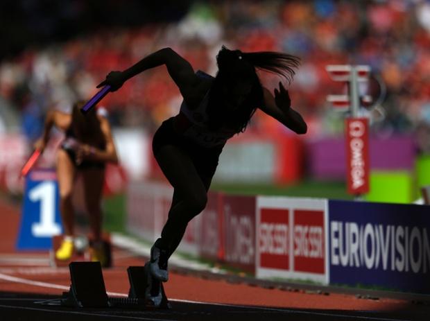 A runner starts in the women's 4x400m relay heats.