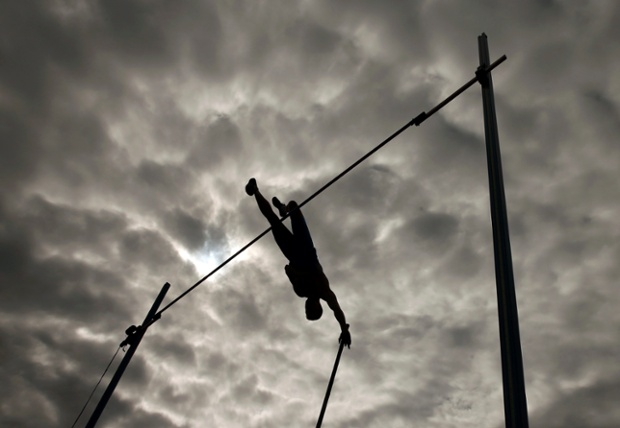 Sergey Kucheryanu of Russia competes in the men's pole vault final.