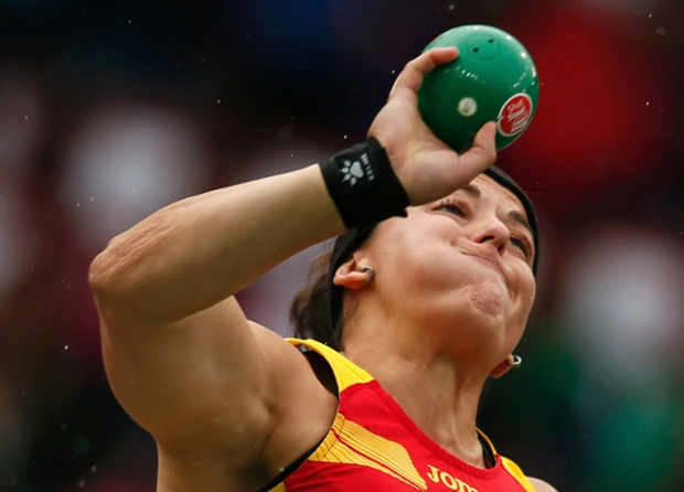 Ursula Ruiz of Spain strains as she competes in the Women's Shot Put qualifiers.