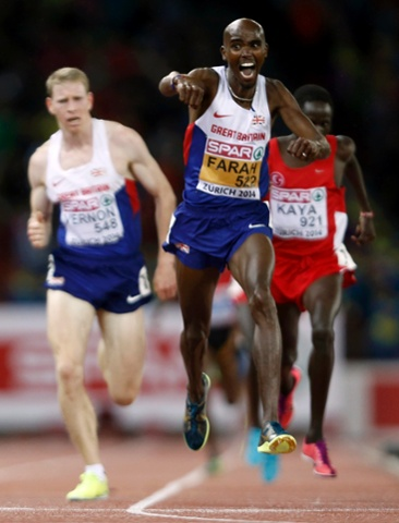 After illness and injury forced him to miss the Commonwealth games, Mo Farah shows what it means to him to be back on the track and winning gold as he crosses the line to win the Men's 10000 metres final.  His triumph in the 5000 metres final  meant that he is now the reigning double European, World and Olympic champion.