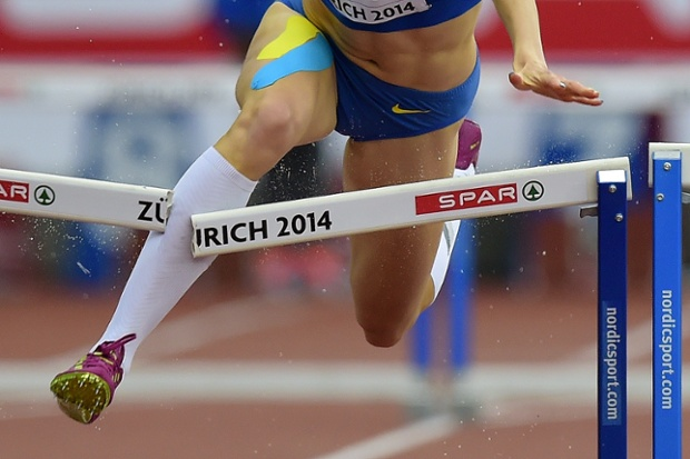 Ukraine's Hanna Ryzhykova crashes out of the Women's 400 metres hurdles heats.