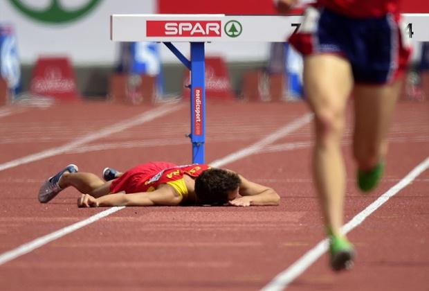 Spain's Victor Garcia falls during the Men's 3000 metre Steeplechase heats.