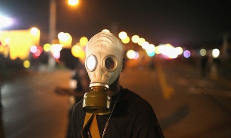 Ferguson demonstrator in gas mask