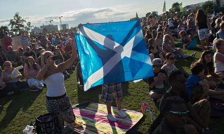 People soak up the atmosphere on Glasgow Green during the buildup to the Glasgow 2014 Commonwealth G