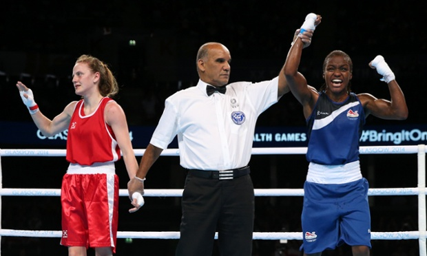 Nicola Adams, right, of England leaps for joy as the judges award her the gold medal as her opponent Michaela Walsh of Northern Ireland looks to her corner.