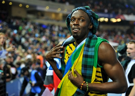 Usain Bolt embraces the host nation as he celebrates Jamaica's 4x100m relay victory.