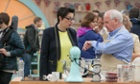It's that time again … Sue Perkins and Norman consult the clock in The Great British Bake Off 2014.