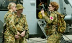 Australian female soldiers prepare to board a Sea King helicopter in 2003.