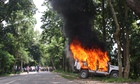A police vehicle on fire in Golaghat, in the Indian state of Assam