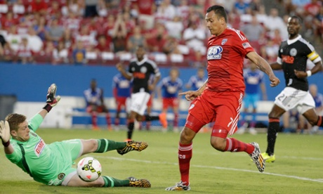 Philadelphia Union goalkeeper Zac MacMath (18) deflects a shot attempt by FC Dallas forward Blas Perez.