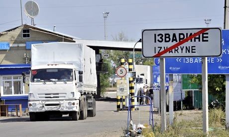 A Russian aid convoy truck crosses the Ukrainian border at Izvarino checkpoint. Photograph: Rogulin Dmitry/ Rogulin Dmitry/ITAR-TASS Photo/Corbis