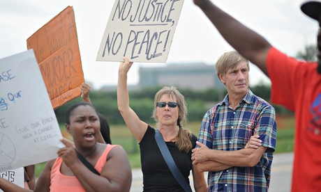 Black and white residents have joined protests on the streets of Ferguson. Photograph: MICHAEL B. THOMAS/AFP/Getty Images