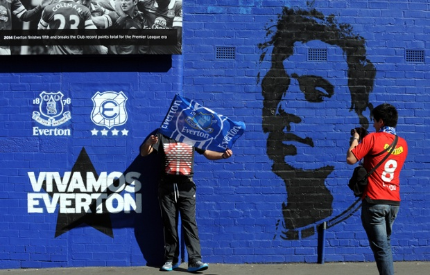 Everton fans outside a sunny Goodison Park before kick-off.