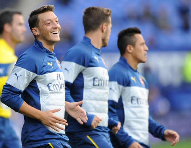 Mesut Ozil of Arsenal warms up with a smile before the start.