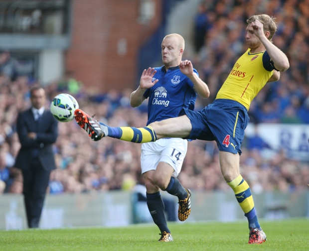 Mertesacker gets booked for an agricultural lunge on Naismith.