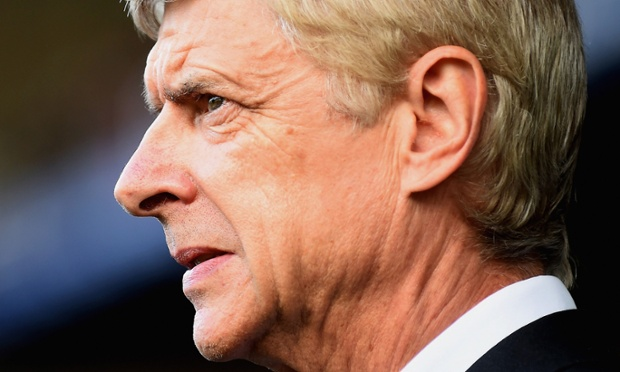 An unhappy Arsene Wenger, the fourth official being his focus at half time.