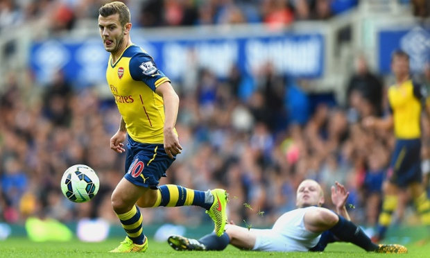 Arsenal's Jack Wilshere found the match tough as he get's the better of Steven Naismith.
