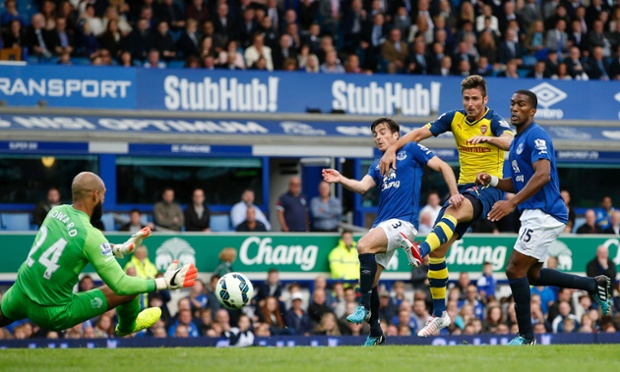 At last Arsenal's Olivier Giroud forces a save from Everton goalkeeper Tim Howard.