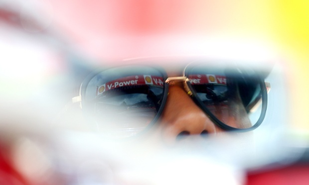 Lewis Hamilton looking reflective in a wing mirror during the drivers' parade before the Belgian Grand Prix at Circuit de Spa-Francorchamps in Belgium.