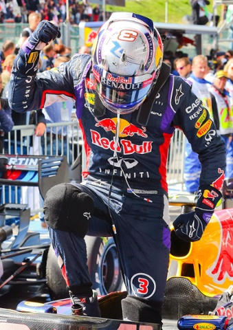 Daniel Ricciardo of Red Bull Racing punches the air as he get's our of his car after winning.