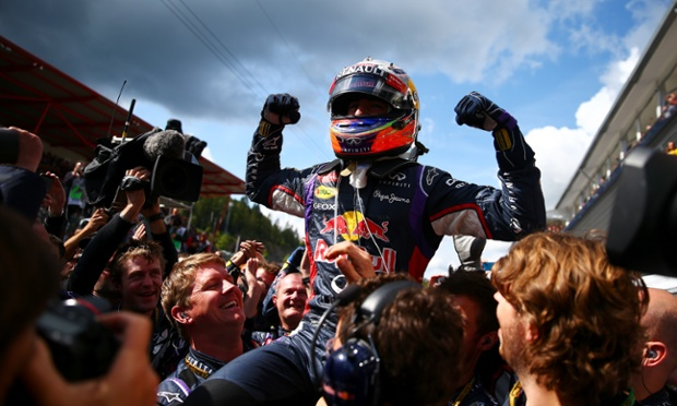 Wnner Red Bull Racing driver Daniel Ricciardo is hoisted by his team in the Parc Ferme.