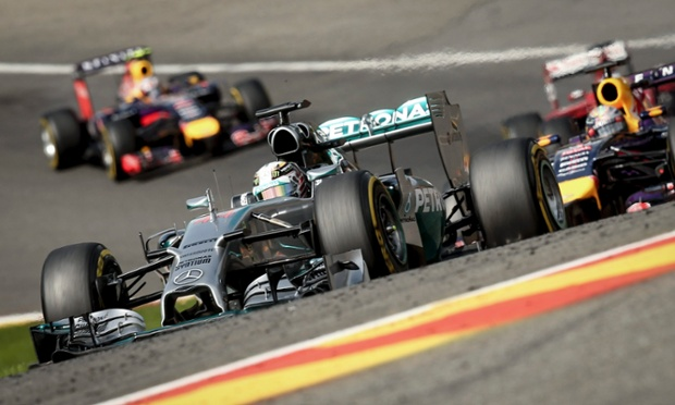 The Mercedes of Lewis Hamilton fighting off the Red Bull cars.