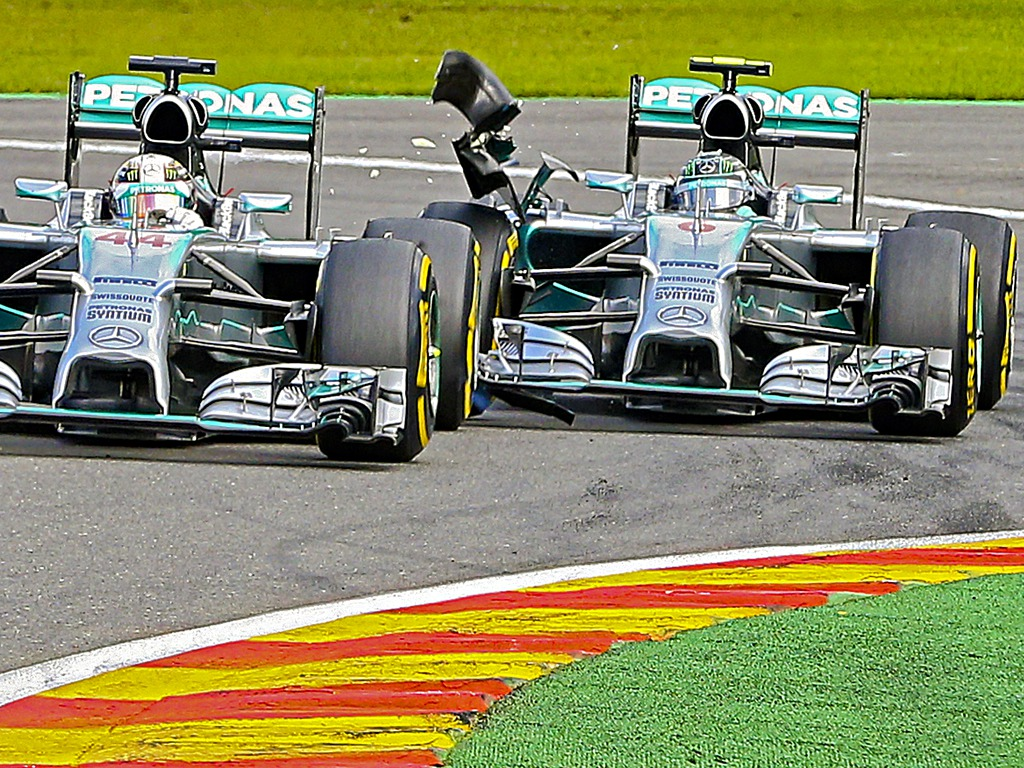Mercedes AMG GP driver Lewis Hamilton, left, has his rear tyre clipped by team mate Nico Rosberg