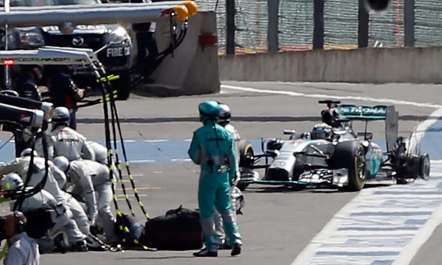 Mercedes driver Lewis Hamilton makes it back to the pit without tyre after Nico Rosberg collided with him.